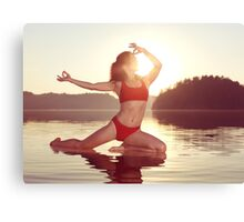 Woman practicing yoga on the water doing Pigeon pose in morning sunlight art photo print Canvas Print