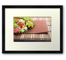 Closeup view of a plate with fresh salad of raw tomatoes Framed Print