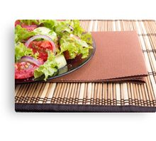 Closeup view of a plate with fresh salad of raw tomatoes Canvas Print