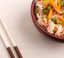 Asian dish of rice noodle in a small wooden bowl Sticker