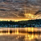 Golden Crepuscular Sunrise over Water. by sunnypicsoz