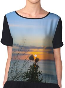 sunset over loop head with silhouetted wild tall thistles Chiffon Top