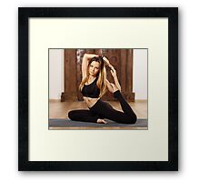 Woman yoga trainer in asana Framed Print