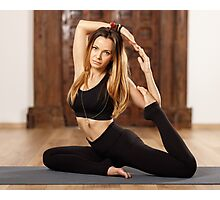 Woman yoga trainer in asana Photographic Print