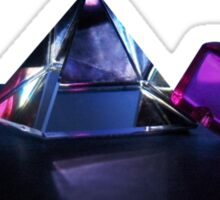 A Purple Cube With A Glass Pyramid Sticker