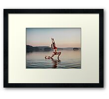 Woman doing Hatha yoga Anjaneyasana Low Lunge pose on the water art photo print Framed Print