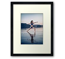 Young woman in blue swimsuit practicing yoga on the water Veerabhadrasana pose art photo print Framed Print