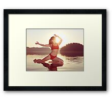 Woman practicing yoga on the water doing Pigeon pose in morning sunlight art photo print Framed Print