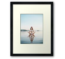 Woman practicing morning sunrise meditation on the water art photo print Framed Print