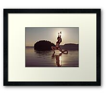 Woman doing yoga Anjaneyasana Low Lunge pose on the water in morning sunlight art photo print Framed Print