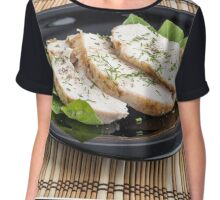 Three slices of roasted chicken on a black plate Chiffon Top