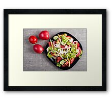 Top view of a small plate of salad made from natural raw vegetables Framed Print