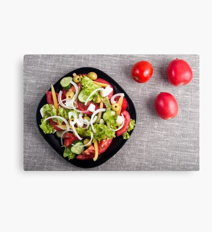 Top view of a small bowl of salad from natural raw vegetables Canvas Print