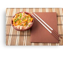 Top view of an Asian bowl of rice noodle and vegetable seasonings Canvas Print