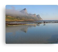 Mountains reflecting in tidal pool Canvas Print
