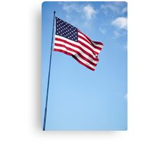 United states of America flag blowing in the wind with clouds and blue sky background Canvas Print