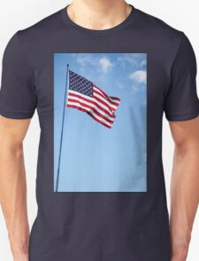 United states of America flag blowing in the wind with clouds and blue sky background Unisex T-Shirt