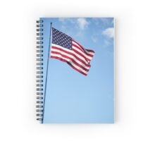 United states of America flag blowing in the wind with clouds and blue sky background Spiral Notebook