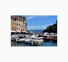 Photography of the beautiful Portofino fishing village in Italy. Aerial view on small bay and colorful houses at town of Portofino in Liguria, Italy. Unisex T-Shirt
