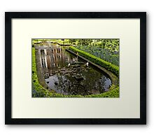 Backyard Tranquility - a Beautifully Landscaped Garden with a Fountain Framed Print
