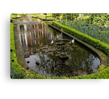Backyard Tranquility - a Beautifully Landscaped Garden with a Fountain Canvas Print
