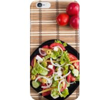 Top view on a fresh vegetable salad with natural ingredients iPhone Case/Skin