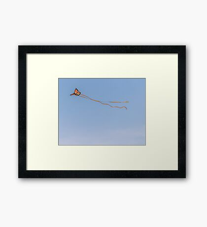 Butterfly kite in the air Framed Print