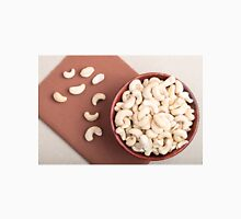 Top view on raw cashew nuts for vegetarian food in a wooden cup Unisex T-Shirt