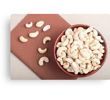 Top view on raw cashew nuts for vegetarian food in a wooden cup Canvas Print