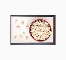 Top view on raw cashew nuts for vegetarian food in a small wooden bowl Unisex T-Shirt