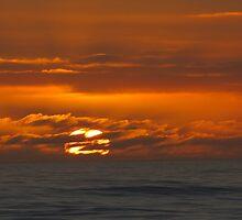 Mercurial seas at sunset by Lee Jones