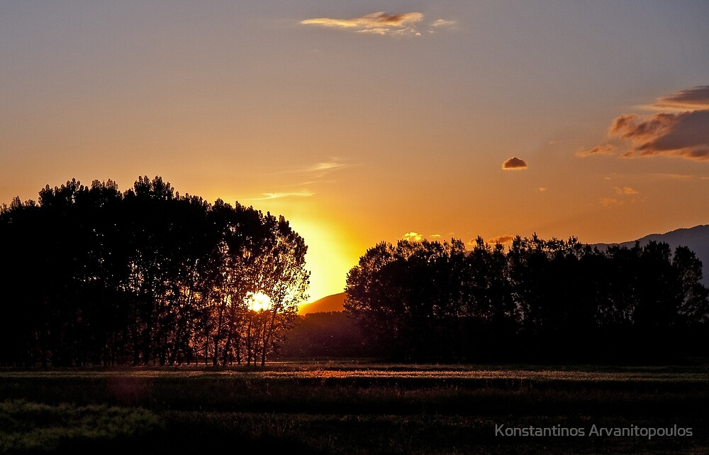 Sunset in the fields by Konstantinos Arvanitopoulos