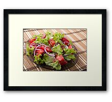 View angle on a fragment of vegetarian salad from fresh vegetables Framed Print