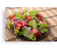 View angle on a fragment of vegetarian salad from fresh vegetables Canvas Print