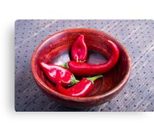 View closeup on hot red chili peppers Canvas Print