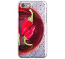 Red raw pepper in a brown wooden bowl iPhone Case/Skin