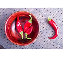 Red raw pepper in a brown wooden bowl Photographic Print