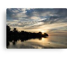 Pale Gold Sunrays - A Cloudy Sunrise with Two Ducks Canvas Print