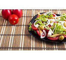 Closeup view fresh natural salad with raw tomato, cucumber, olives, onion, lettuce Photographic Print