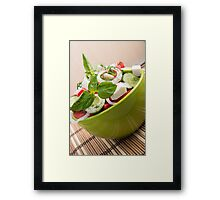 Vertical view close-up on a green bowl with a salad Framed Print