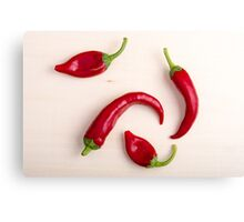 Top view of hot chili peppers Canvas Print