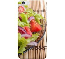 Side view of the transparent plate with the vegetarian salad closeup iPhone Case/Skin