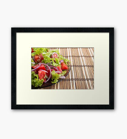 Side view of the transparent plate with the vegetarian salad closeup Framed Print