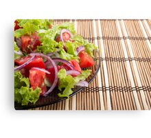 Side view of the transparent plate with the vegetarian salad closeup Canvas Print
