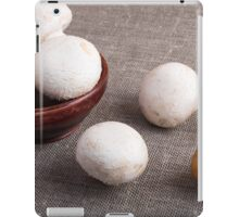 Raw champignon mushrooms and onions iPad Case/Skin