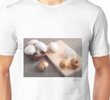 Champignon mushrooms and onions on the table Unisex T-Shirt