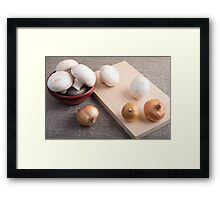 Champignon mushrooms and onions on the table Framed Print