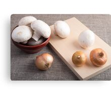 Champignon mushrooms and onions on the table Canvas Print