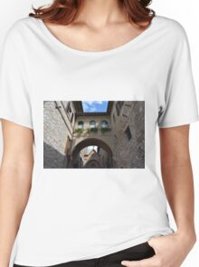 Stone buildings from Assisi with medieval arches and decorations. Women's Relaxed Fit T-Shirt