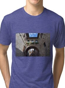 Stone buildings from Assisi with medieval arches and decorations. Tri-blend T-Shirt